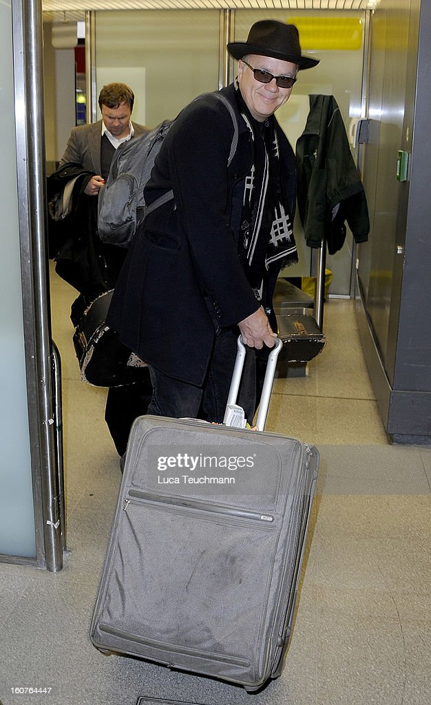 <a gi-track='captionPersonalityLinkClicked' href=/galleries/search?phrase=Tim+Robbins&family=editorial&specificpeople=182439 ng-click='$event.stopPropagation()'>Tim Robbins</a> arrives at Tegel airport on February 5, 2013 in Berlin, Germany.