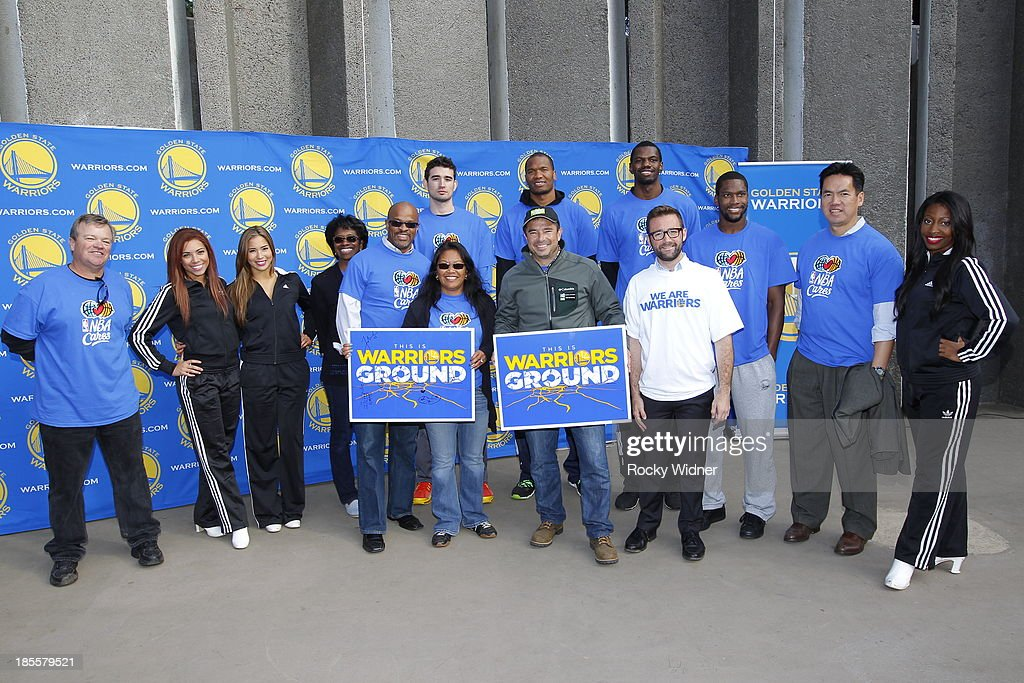 Tim Roye, Joe Alexander, Marreese Speights, Dewayne Dedmon, and Toney Douglas pose with local officials and some Warrior Girls after their clean up of McLaren park during Warriors Day Of Service as part of NBA Cares Week Of Service on October 21, 2013 in San Francisco, California.