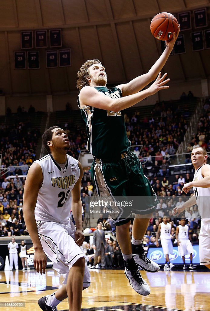 Tim Rusthoven #22 of the William & Mary Tribe shoots the ball as A.J. Hammons #20 of the Purdue Boilermakers watches at Mackey Arena on December 29, 2012 in West Lafayette, Indiana. Purdue defeated William & Mary 73-66.
