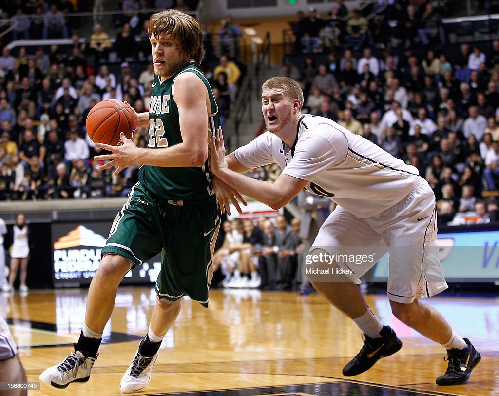 Tim Rusthoven #22 of the William & Mary Tribe takes the ball to the hoop against Travis Carroll #50 of the Purdue Boilermakers at Mackey Arena on December 29, 2012 in West Lafayette, Indiana. Purdue defeated William & Mary 73-66.