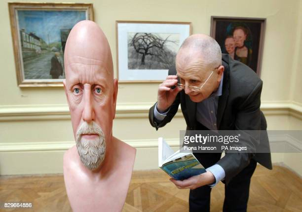 Tim Sayer inspects an anamorphic work in painted glass fibre by John Patrick Humphreys entitled Edward Powell As Pope Paul III for sale at 11 at the...