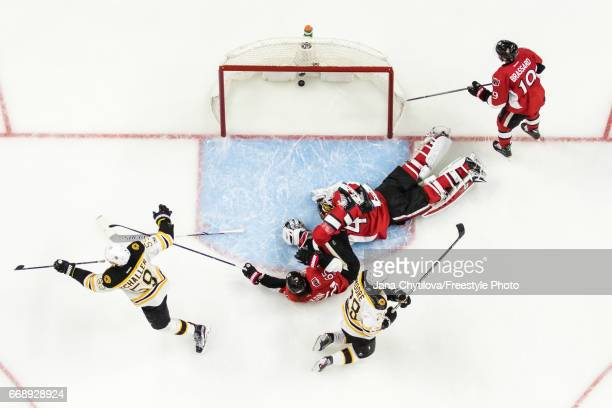 Tim Schaller of the Boston Bruins in Game celebrates his second period shorthanded goal as Erik Karlsson Craig Anderson and Derick Brassard of the...