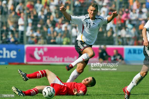 Tim Scheffler of Germany in action with Gabriel Luechinger of Switzerland during the men's U15 international friendly match between Germany and...
