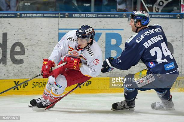 Tim Schuele of the Duesseldorfer EG and Andre Rankel of the Eisbaeren Berlin during the DEL game between the Eisbaeren Berlin and Duesseldorfer EG on...