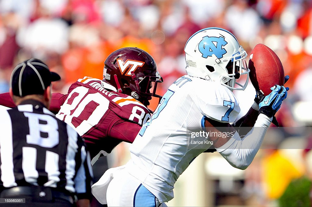Tim Scott #7 of the North Carolina Tar Heels intercepts a pass intended for Demitri Knowles #80 of the Virginia Tech Hokies on October 6, 2012 at Kenan Stadium in Chapel Hill, North Carolina.