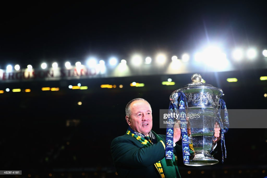 Tim Sheens the head coach of Australia with the winners trophy after his sides 342 victory during the Rugby League World Cup Final between Australia...