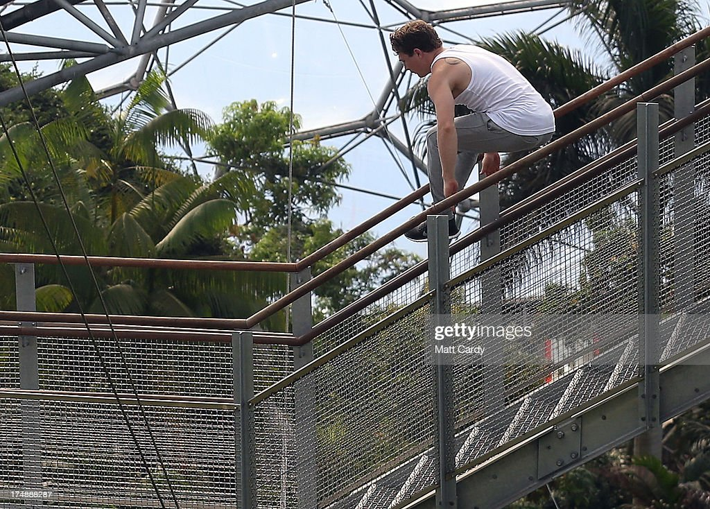 Tim Sheiff, professional freerunner and parkour expert jumps a flight of stairs inside the Eden Project's Rainforest Biome on July 29, 2013 in St Austell, England. Pip Andersen and Tim Shieff who are both members of the pro freerunning team Storm Freerun, were at the Eden Project to help make a promotional video for the Cornish attraction. Following a record dry July, visitor numbers to the region are reported to be higher than previous years and many attractions and resorts are hoping for a busy summer season.