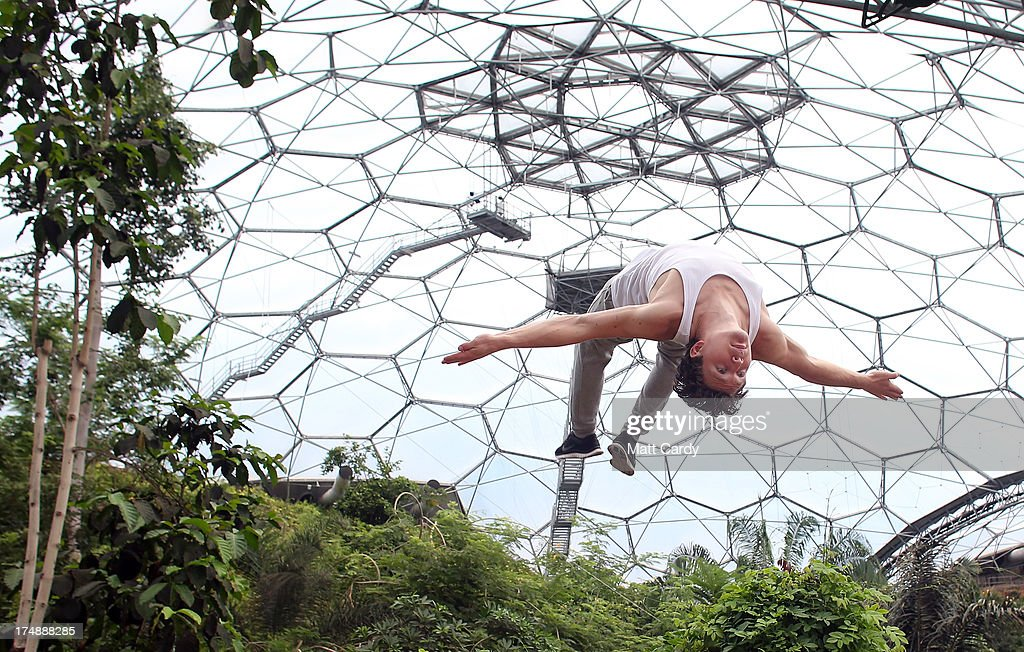 Tim Sheiff, professional freerunner and parkour expert somersaults inside the Eden Project's Rainforest Biome on July 29, 2013 in St Austell, England. <a gi-track='captionPersonalityLinkClicked' href=/galleries/search?phrase=Pip+Andersen&family=editorial&specificpeople=5512792 ng-click='$event.stopPropagation()'>Pip Andersen</a> and Tim Shieff who are both members of the pro freerunning team Storm Freerun, were at the Eden Project to help make a promotional video for the Cornish attraction. Following a record dry July, visitor numbers to the region are reported to be higher than previous years and many attractions and resorts are hoping for a busy summer season.