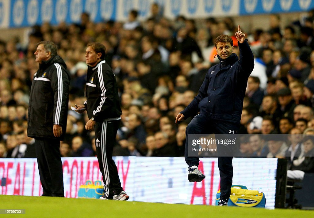 <a gi-track='captionPersonalityLinkClicked' href=/galleries/search?phrase=Tim+Sherwood&family=editorial&specificpeople=4503354 ng-click='$event.stopPropagation()'>Tim Sherwood</a> interim manager of Tottenham Hotspur (R) gives instructions as <a gi-track='captionPersonalityLinkClicked' href=/galleries/search?phrase=Sam+Allardyce&family=editorial&specificpeople=214691 ng-click='$event.stopPropagation()'>Sam Allardyce</a> manager of West Ham United (L) looks on during the Capital One Cup Quarter-Final match between Tottenham Hotspur and West Ham United at White Hart Lane on December 18, 2013 in London, England.