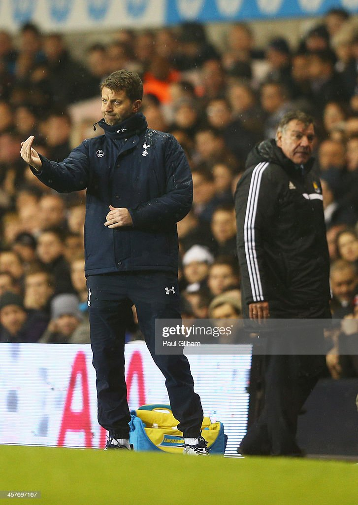 <a gi-track='captionPersonalityLinkClicked' href=/galleries/search?phrase=Tim+Sherwood&family=editorial&specificpeople=4503354 ng-click='$event.stopPropagation()'>Tim Sherwood</a> interim manager of Tottenham Hotspur (L) gives instructions as <a gi-track='captionPersonalityLinkClicked' href=/galleries/search?phrase=Sam+Allardyce&family=editorial&specificpeople=214691 ng-click='$event.stopPropagation()'>Sam Allardyce</a> manager of West Ham United (R) looks on during the Capital One Cup Quarter-Final match between Tottenham Hotspur and West Ham United at White Hart Lane on December 18, 2013 in London, England.