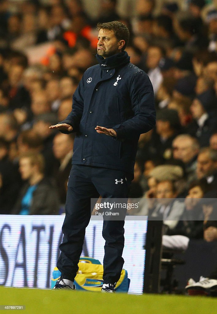 <a gi-track='captionPersonalityLinkClicked' href=/galleries/search?phrase=Tim+Sherwood&family=editorial&specificpeople=4503354 ng-click='$event.stopPropagation()'>Tim Sherwood</a> interim manager of Tottenham Hotspur signals during the Capital One Cup Quarter-Final match between Tottenham Hotspur and West Ham United at White Hart Lane on December 18, 2013 in London, England.