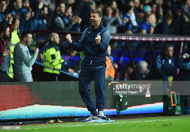 Tim Sherwood manager of Aston Villa celebrates as Christian Benteke of Aston Villa scores their second goal during the Barclays Premier League match...