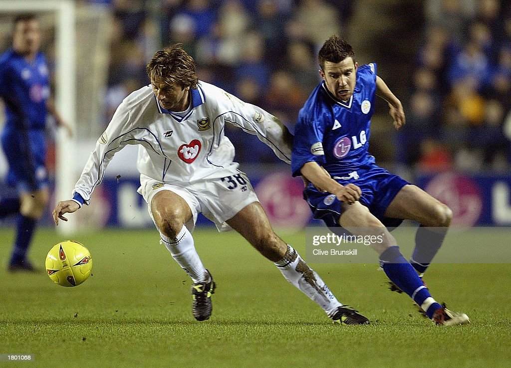 Tim Sherwood of Portsmouth holds off Muzzy Izzet of Leicester during the Nationwide League Division One match between Leicester City and Portsmouth at Walkers Stadium, Leicester, England on February 17, 2003.
