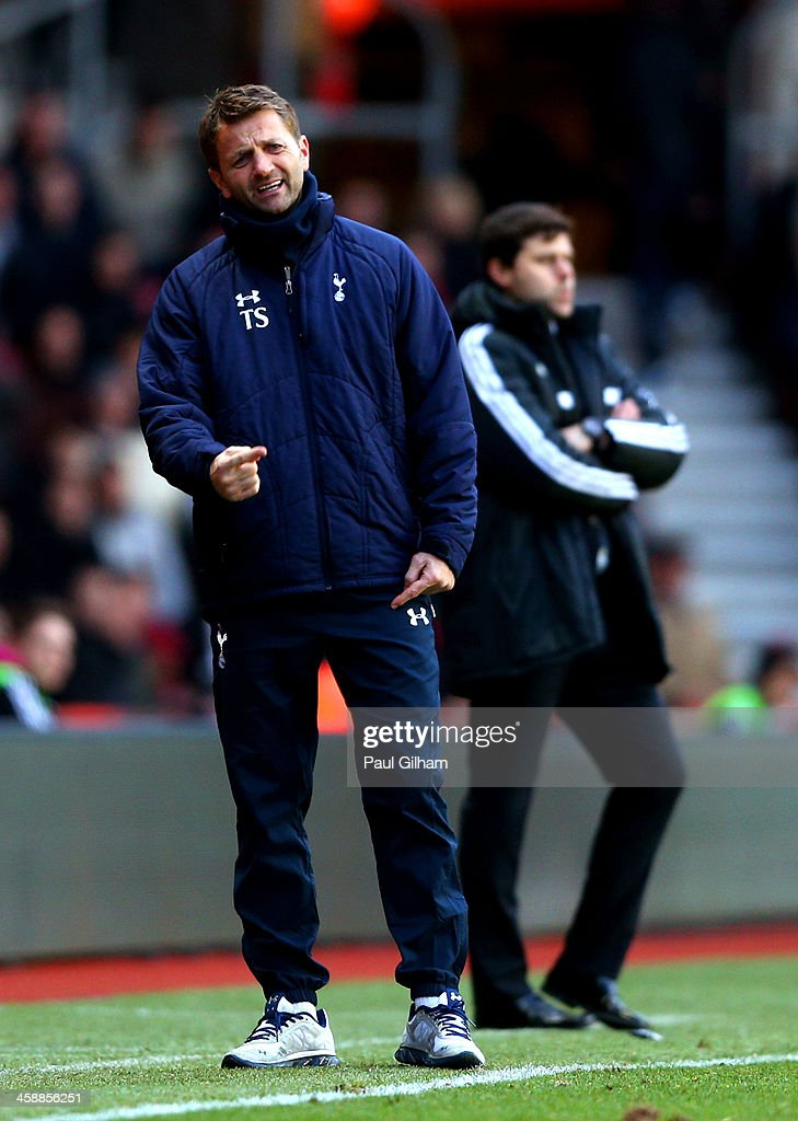 <a gi-track='captionPersonalityLinkClicked' href=/galleries/search?phrase=Tim+Sherwood&family=editorial&specificpeople=4503354 ng-click='$event.stopPropagation()'>Tim Sherwood</a> the Spurs interim manager directs his players as <a gi-track='captionPersonalityLinkClicked' href=/galleries/search?phrase=Mauricio+Pochettino&family=editorial&specificpeople=234444 ng-click='$event.stopPropagation()'>Mauricio Pochettino</a> the Southampton manager looks on during the Barclays Premier League match between Southampton and Tottenham Hotspur at St Mary's Stadium on December 22, 2013 in Southampton, England.