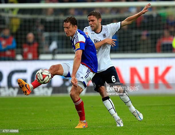 Tim Siedschlag of Kiel challenges Dominik Stahl of Muenchen during the 2 Bundesliga Playoff First Leg between Holstein Kiel and 1860 Muenchen at...