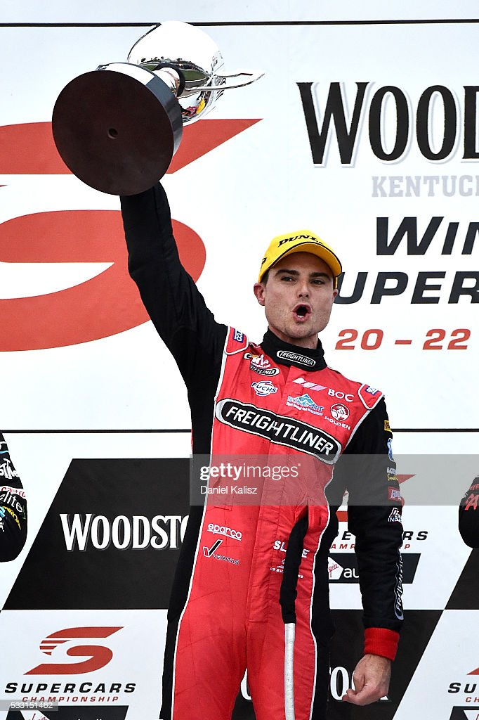 Tim Slade driver of the Freightliner Racing Holden Commodore VF celebrates after winning race 1 of the V8 Supercars Winton round at Winton Raceway on...