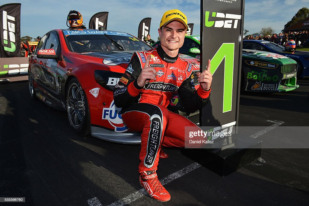 Tim Slade driver of the Freightliner Racing Holden Commodore VF celebrates after winning race 2 for the V8 Supercars Winton round at Winton Raceway...