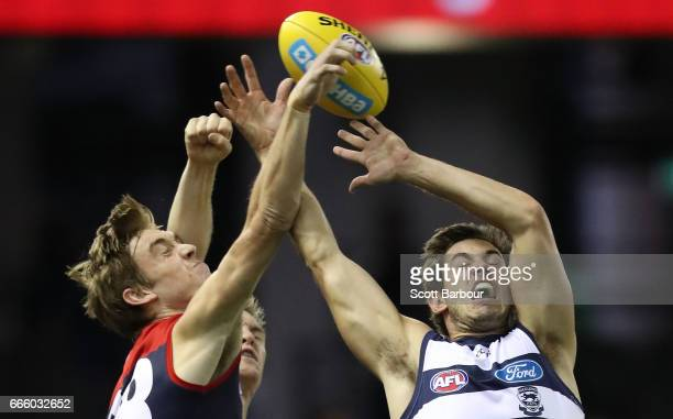 Tim Smith of the Demons and Daniel Menzel of the Cats compete for the ball during the round three AFL match between the Geelong Cats and the...