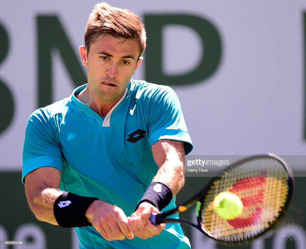 Tim Smyczek hits a backhand in his match against Benjamin Becker of Germany during the BNP Parisbas Open at the Indian Wells Tennis Garden on March 11, 2015 in Indian Wells, California.