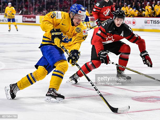 Tim Soderlund of Team Sweden skates the puck against Thomas Chabot of Team Canada during the 2017 IIHF World Junior Championship semifinal game at...