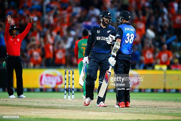 Tim Southee and Daniel Vettori of New Zealand conratulate each other during the 2015 ICC Cricket World Cup match between Bangladesh and New Zealand...