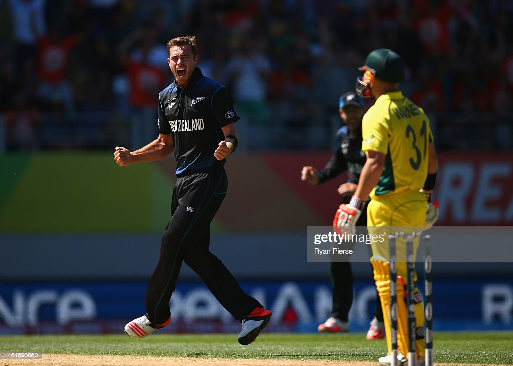 <a gi-track='captionPersonalityLinkClicked' href=/galleries/search?phrase=Tim+Southee&family=editorial&specificpeople=4205733 ng-click='$event.stopPropagation()'>Tim Southee</a> of New Zealand celebrates after taking the wicket of <a gi-track='captionPersonalityLinkClicked' href=/galleries/search?phrase=David+Warner+-+Cricketer&family=editorial&specificpeople=4262255 ng-click='$event.stopPropagation()'>David Warner</a> of Australia during the 2015 ICC Cricket World Cup match between Australia and New Zealand at Eden Park on February 28, 2015 in Auckland, New Zealand.