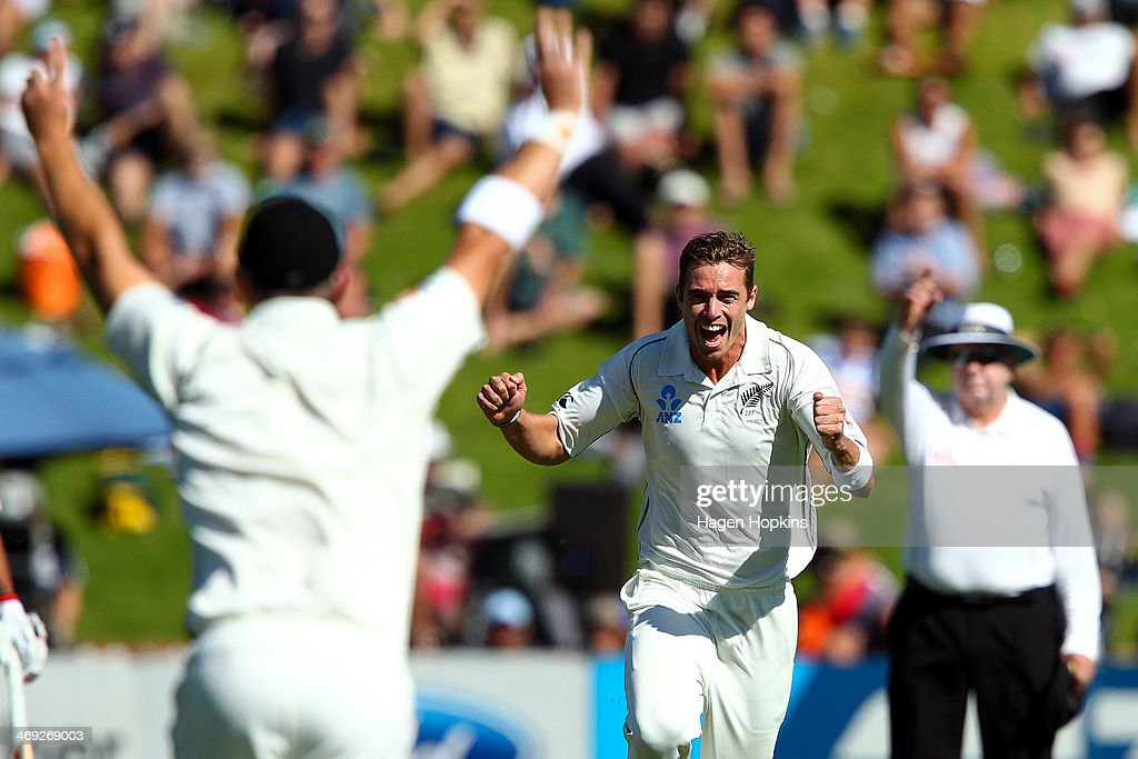 Tim Southee of New Zealand celebrates after taking the wicket of Murali Vijay of India during day one of the 2nd Test match between New Zealand and India on February 14, 2014 in Wellington, New Zealand.