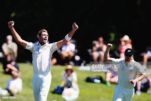 Tim Southee of New Zealand celebrates claiming the wicket of Angelo Mathews of Sri Lanka during day four of the First Test match between New Zealand...
