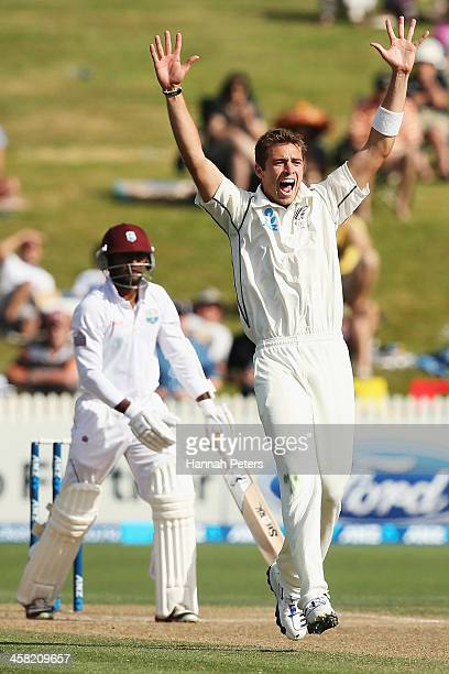 Tim Southee of New Zealand celebrates claiming the wicket of Veerasammy Permaul of the West Indies during day three of the Third Test match between...