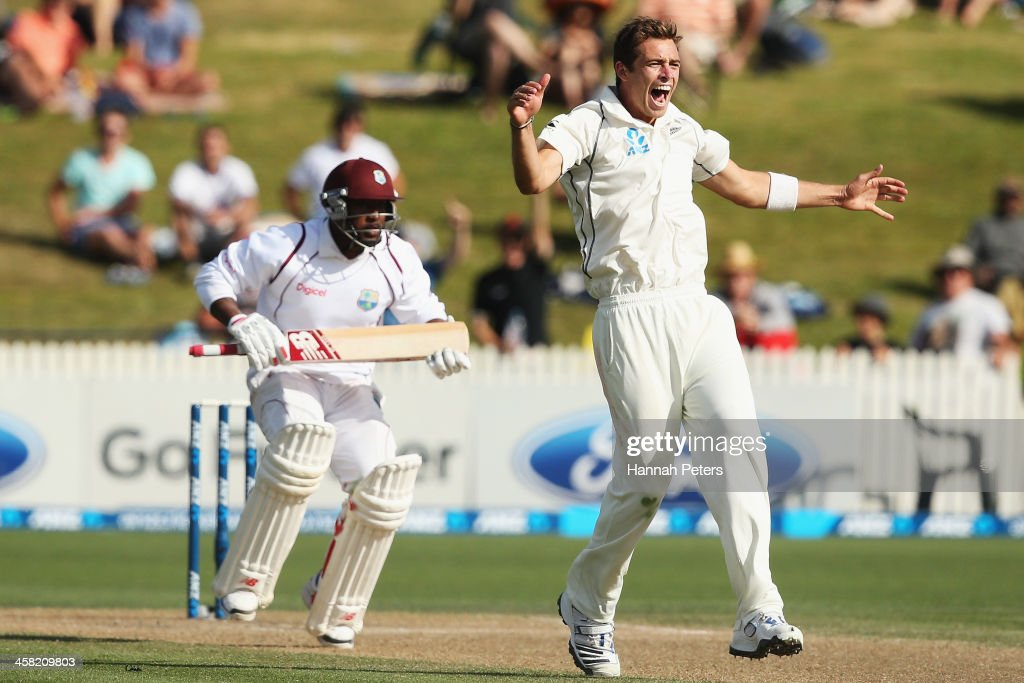 <a gi-track='captionPersonalityLinkClicked' href=/galleries/search?phrase=Tim+Southee&family=editorial&specificpeople=4205733 ng-click='$event.stopPropagation()'>Tim Southee</a> of New Zealand celebrates claiming the wicket of <a gi-track='captionPersonalityLinkClicked' href=/galleries/search?phrase=Tino+Best&family=editorial&specificpeople=209064 ng-click='$event.stopPropagation()'>Tino Best</a> of the West Indies during day three of the Third Test match between New Zealand and the West Indies at Seddon Park on December 21, 2013 in Hamilton, New Zealand.