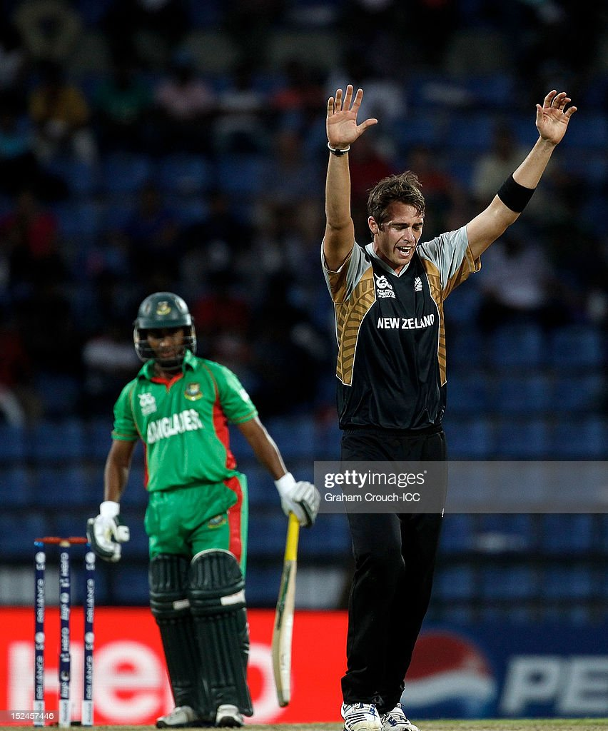 <a gi-track='captionPersonalityLinkClicked' href=/galleries/search?phrase=Tim+Southee&family=editorial&specificpeople=4205733 ng-click='$event.stopPropagation()'>Tim Southee</a> of New Zealand celebrates dismissing <a gi-track='captionPersonalityLinkClicked' href=/galleries/search?phrase=Mohammad+Ashraful&family=editorial&specificpeople=224689 ng-click='$event.stopPropagation()'>Mohammad Ashraful</a> of Bangladesh during the ICC World T20 Group D match between New Zealand and Bangladesh at Pallekele Cricket Stadium on September 21, 2012 in Kandy, Sri Lanka.