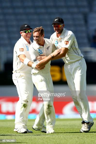 Tim Southee of New Zealand celebrates his wicket of Rohit Sharma of India with Corey Anderson and Peter Fulton during day four of the First Test...
