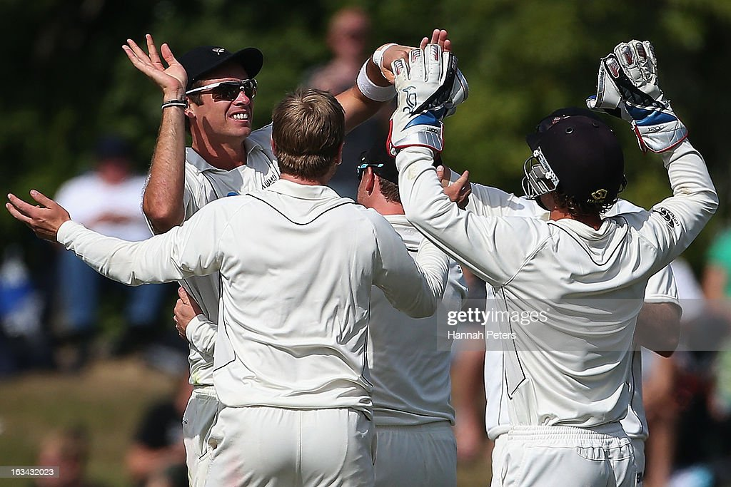 Tim Southee of New Zealand celebrates running out Joe Root of England during day five of the First Test match between New Zealand and England at University Oval on March 10, 2013 in Dunedin, New Zealand.