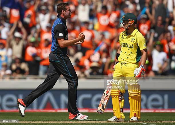 Tim Southee of New Zealand celebrates taking the wicket of David Warner of Australia during the 2015 ICC Cricket World Cup match between Australia...