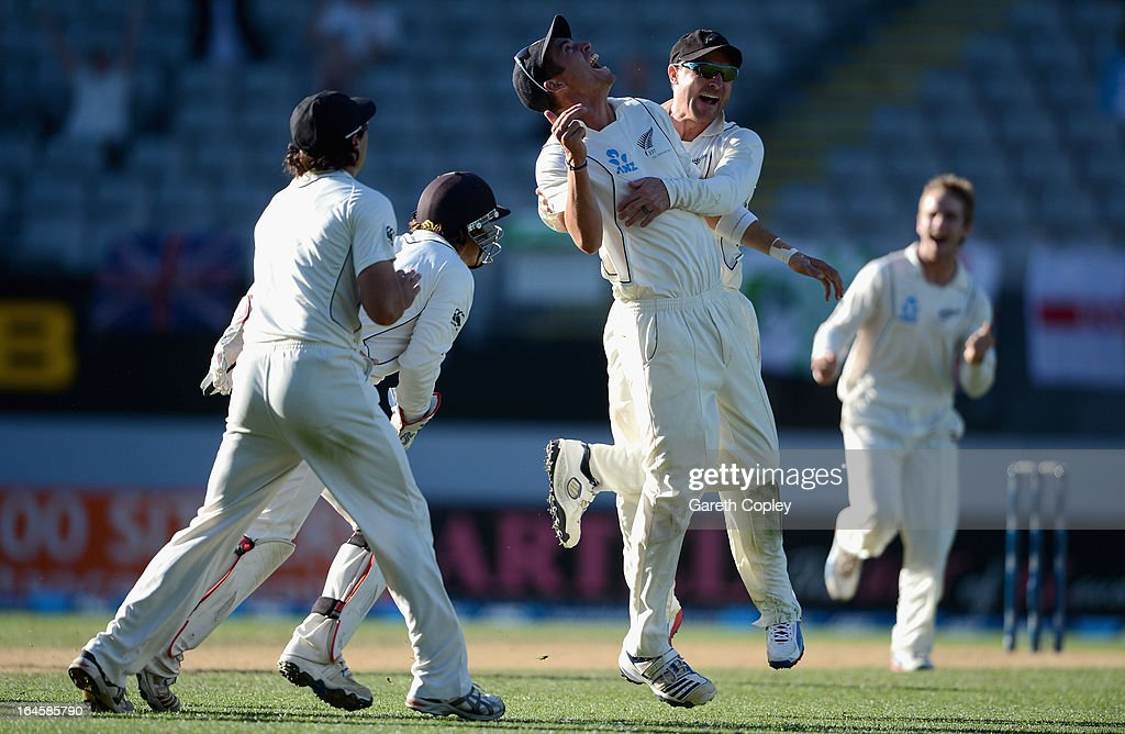 <a gi-track='captionPersonalityLinkClicked' href=/galleries/search?phrase=Tim+Southee&family=editorial&specificpeople=4205733 ng-click='$event.stopPropagation()'>Tim Southee</a> of New Zealand celebrates with <a gi-track='captionPersonalityLinkClicked' href=/galleries/search?phrase=Brendon+McCullum&family=editorial&specificpeople=208154 ng-click='$event.stopPropagation()'>Brendon McCullum</a> after catching out Steven Finn of England during day four of the Third Test match between New Zealand and England at Eden Park on March 25, 2013 in Auckland, New Zealand.