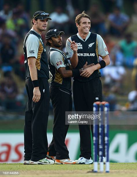 Tim Southee of New Zealand celebrates with Kyle Mills and Roneel Hira after dismissing West Indies captain Darren Sammy during the ICC World Twenty20...