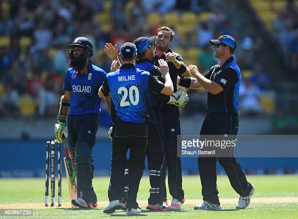 Tim Southee of New Zealand celebrates with teammates after taking the wicket of Moeen Ali of England during the 2015 ICC Cricket World Cup match...