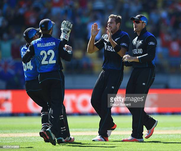 Tim Southee of New Zealand celebrates with teammates after taking the wicket of Chris Woakes of England during the 2015 ICC Cricket World Cup match...