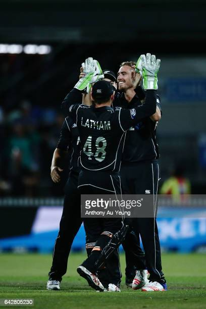 Tim Southee of New Zealand celebrates with teammates for the wicket of Farhaan Behardien of South Africa during the First One Day International match...
