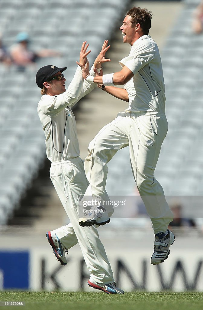 <a gi-track='captionPersonalityLinkClicked' href=/galleries/search?phrase=Tim+Southee&family=editorial&specificpeople=4205733 ng-click='$event.stopPropagation()'>Tim Southee</a> of New Zealand (R) celebtrates the wicket of Nick Compton of England during day four of the Third Test match between New Zealand and England at Eden Park on March 25, 2013 in Auckland, New Zealand.