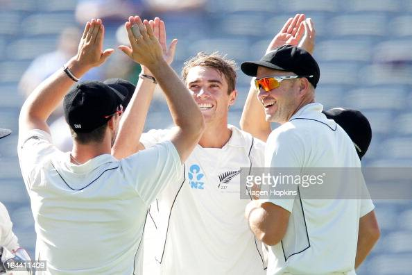 Tim Southee of New Zealand is congratulated by teammates Hamish Rutherford and Peter Fulton after dismissing Ian Bell of England during day three of...