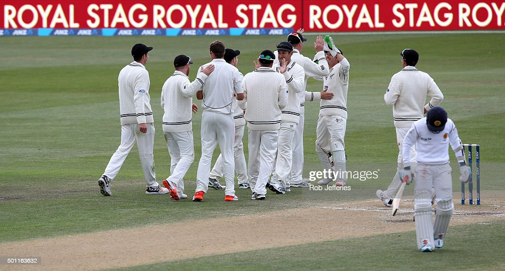 Tim Southee of New Zealand is congratulated on the dismissal of Kusal Mendis of Sri Lanka by his teammates during day four of the First Test match...