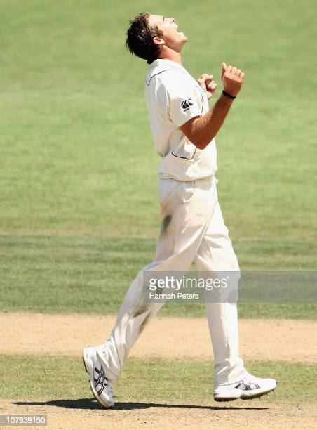 Tim Southee of the Black Caps celebrates the wicket of Adnan Akmal of Pakistan during day three of the First Test match between the New Zealand Black...