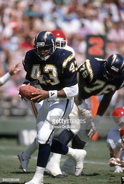Tim Spencer of the San Diego Chargers carries the ball against the Kansas City Chiefs during an NFL football game September 24 1989 at Jack Murphy...