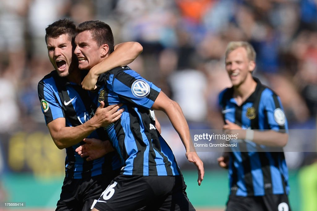 Tim Stegerer of Saarbruecken celebrates with teammates after scoring his team's second goal during the DFB Cup first round match between 1. FC Saarbrücken and Werder Bremen on August 4, 2013 in Saarbruecken, Germany.