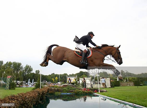Tim Stockdale riding Roland II clears the water jump during the Old Lodge Queen Elizabeth II Cup on July 26 in Hickstead England