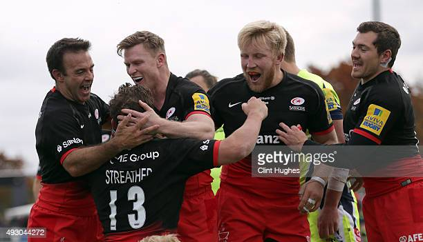 Tim Streather of Saracens celebrates with his teammates after he scores a try for his side during the Aviva Premiership match between Saracens and...