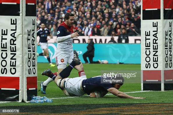Tim Swinson of Scotland dives over to score his team's second try during the RBS Six Nations match between France and Scotland at Stade de France on...