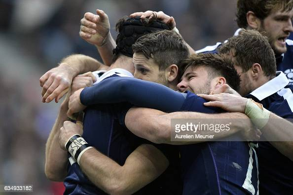 Tim Swinson of Scotland is congratulated by teammates after scoring a try during the RBS Six Nations match between France and Scotland at Stade de...