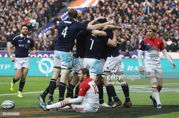 Tim Swinson of Scotland is congratulated by teammates after scoring his team's second try during the RBS Six Nations match between France and...